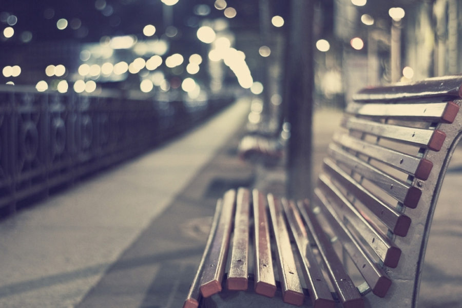 Empty bench in urban area
