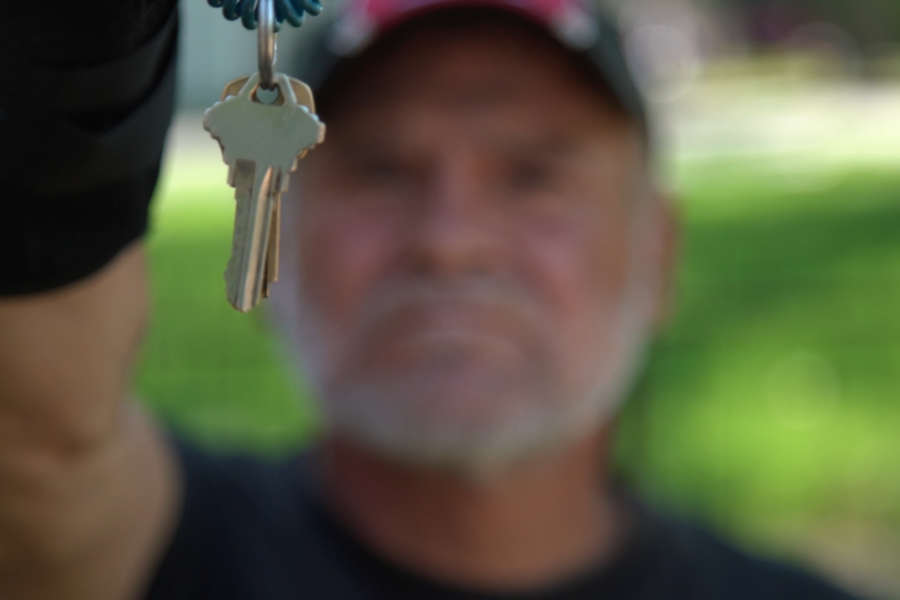 Man holding up new set of keys