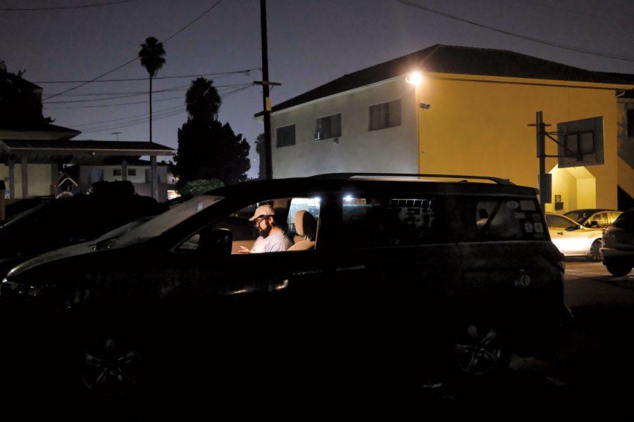 Man sitting in car outside
