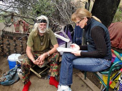 Surveying homeless man
