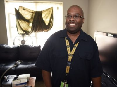 Smiling man inside new housing