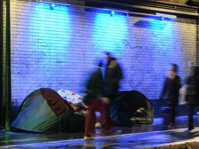 Homeless people underneath train tracks in London