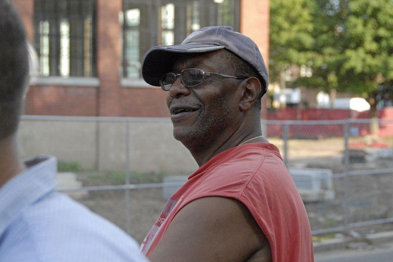 Homeless man speaking outside the Swift Factory