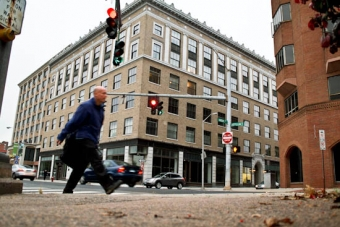 Man walking outside of urban building