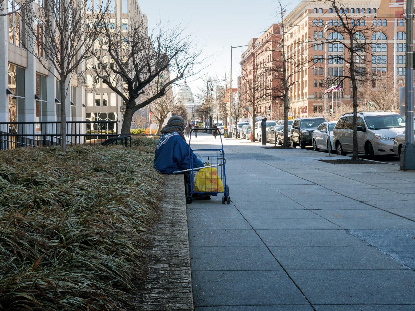 Man sitting on a public street