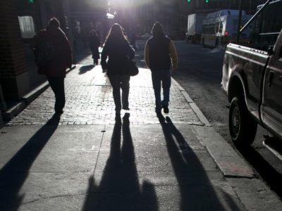 Teens walking at night in city