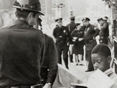 Old photo of cops arresting man