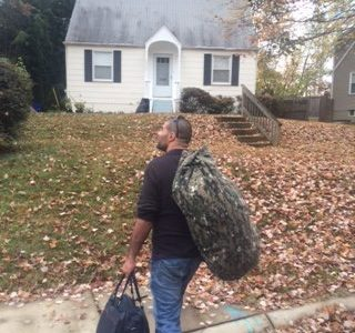 Homeless man entering new house