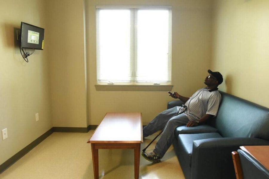 Man watching TV in new housing