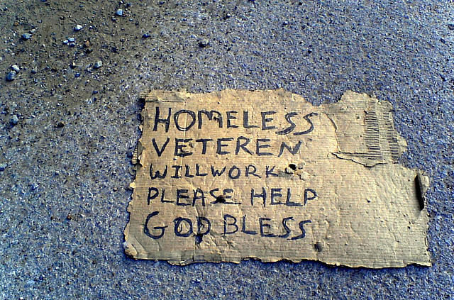 "Homeless Veteran's signage reading ""Will Work, Please Help."""