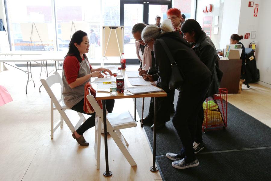 Community members signing paperwork