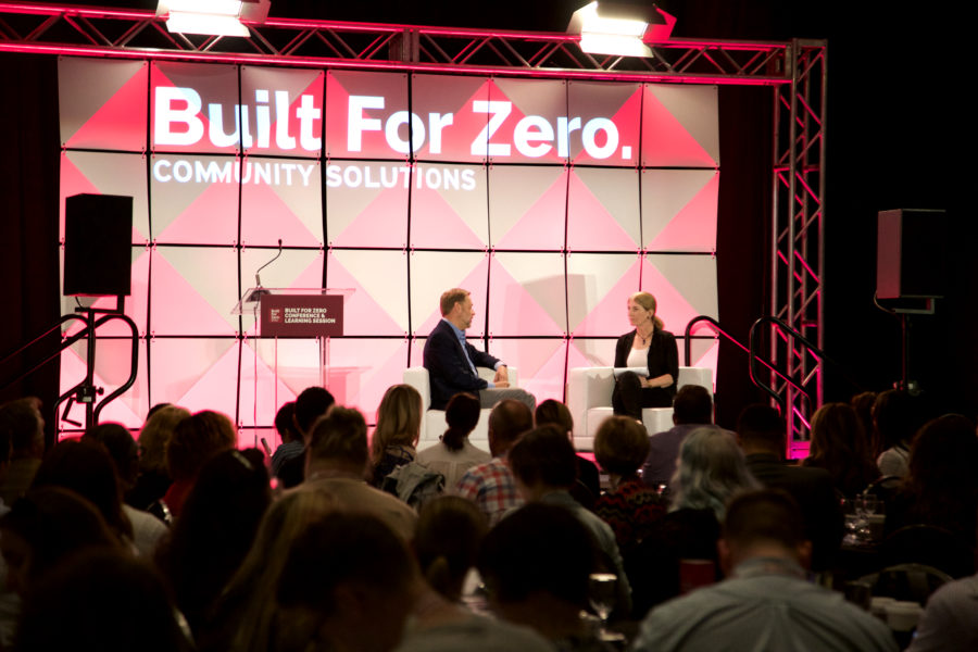 Built for Zero conference with panel members discussing on stage