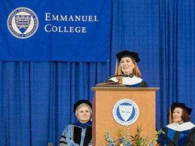 Rosanne Haggerty giving a speech at Emmanuel College