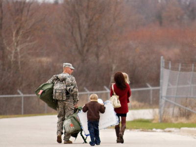 Veteran walking with family