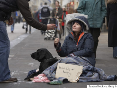 Homeless woman asking for donations