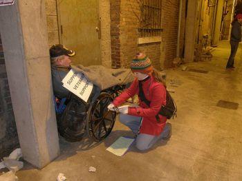 Interviewing homeless veteran in a wheelchair
