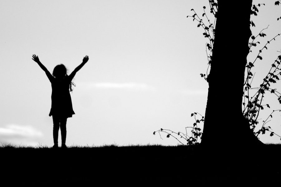 Young girl celebrating outside