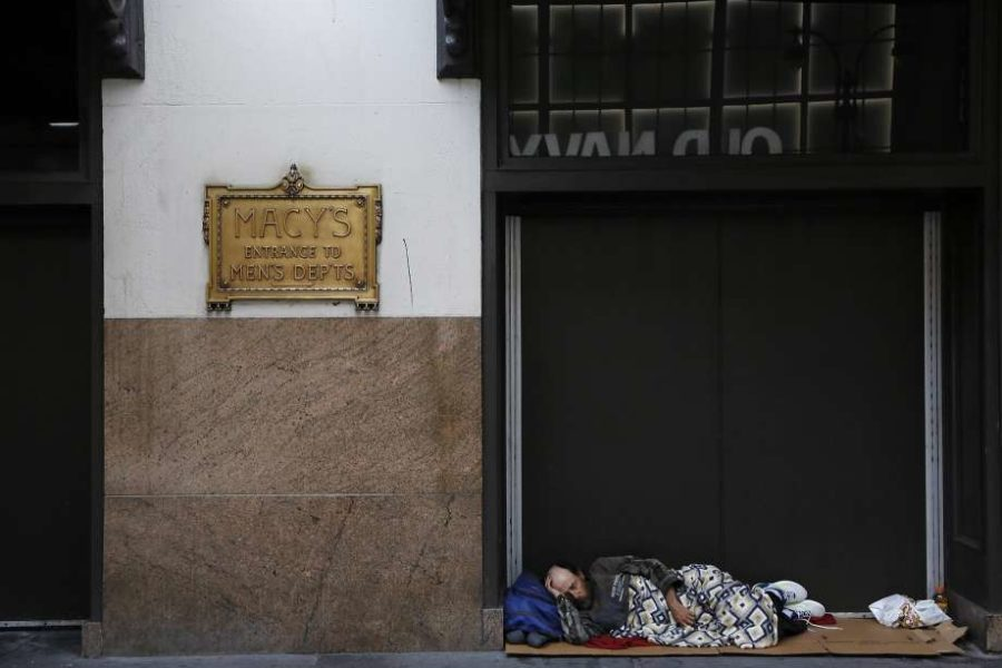 Homeless Man sleeping outside Macy's