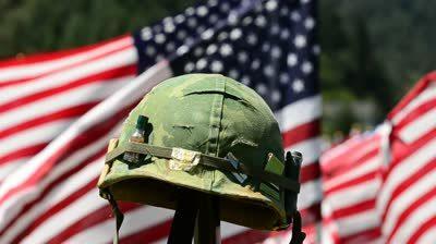 Army helmet by flag