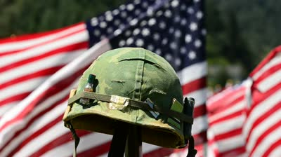 Army helmet by flag