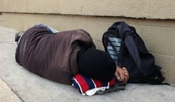Homeless man asleep outside