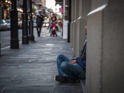 Homeless veteran sitting in doorway