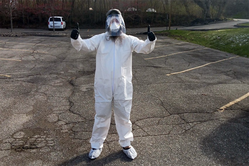 Avalon Housing Property Management Team Lead Joel Barson wearing personal protective equipment in order to enter a unit. Many of the Michigan-based housing provider's procedures have moved online during the pandemic.