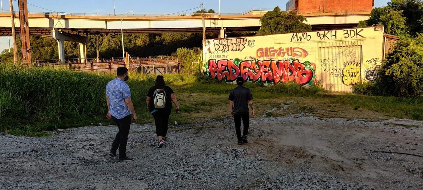 Greater Kansas City outreach workers walking near underpass