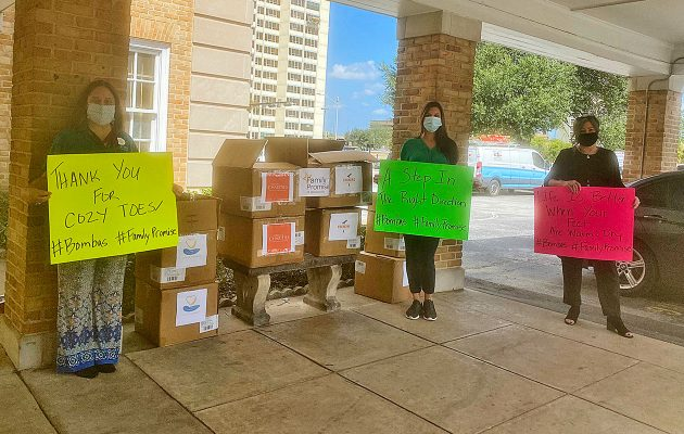 Tamilla Drew of Catholic Charities, Jennifer Smith of Giving Closet and Monique Elton of Changing Homelessness at the sock giveaway sponsored by Family Promise