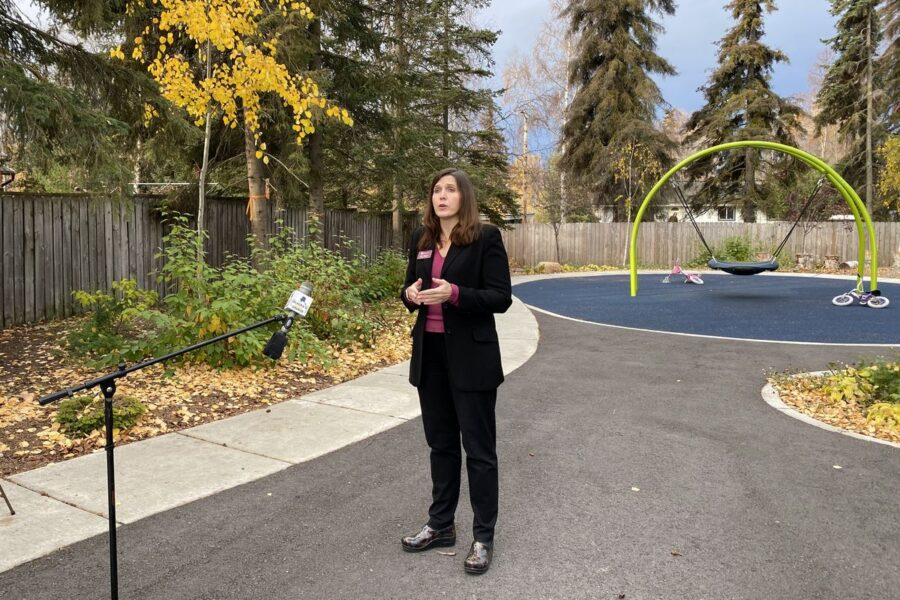 Lisa Aquino with Catholic Social Services speaks with reporters outside Clare House, Oct. 9, 2020. (Paula Dobbyn / ADN)