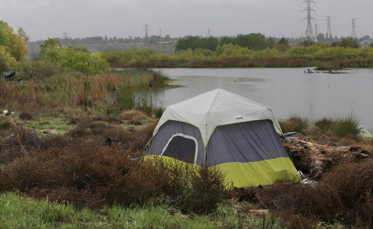 In this file photo from April 2020, a homeless shelter sits at the Weir Water Control basin. Alex Horvath, The Bakersfield-Californian
