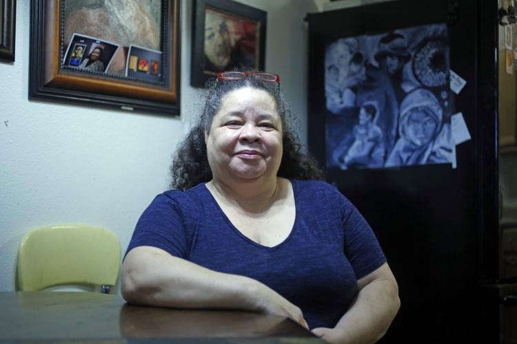 With help from The Life Link and the Housing First initiative, Jeanelle Moore found a place to live — moving up from a fleabag motel with no lock on the door to a midtown apartment complex.