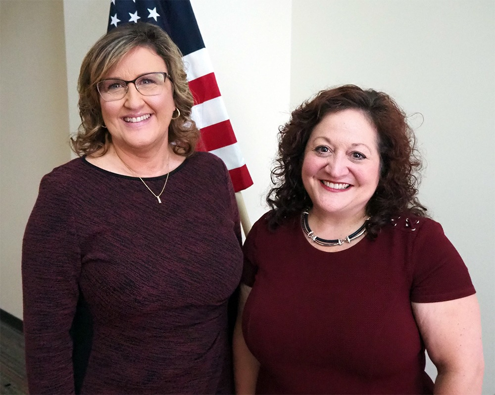 Mary Simons, Executive Director/CEO of Open Doors Homeless Coalition, and Jodie Picciano Swanson, homeless program manager for the Gulf Coast Veterans Healthcare System
