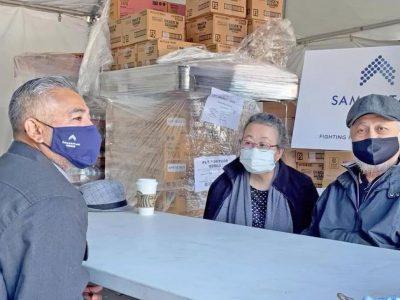 Case manager Jorge Mendoza with Edwina and Demetrio Rivera. Photo courtesy of the Samaritan House.