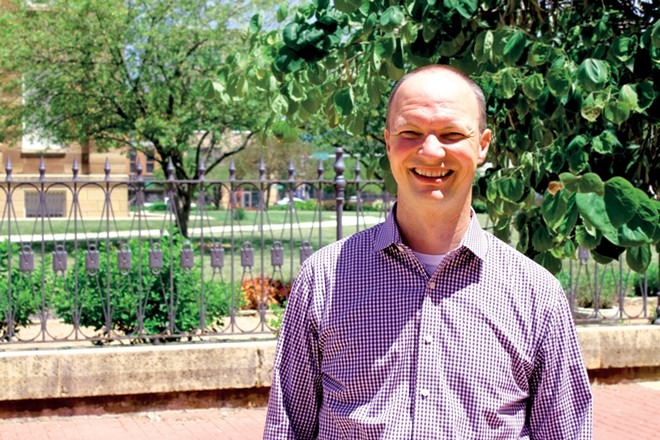 """Josh Sabo, formerly pastor at Central Baptist Church, is the coordinator of Heartland Continuum of Care. """"Homelessness is a complex challenge, but it is solvable,"""" says Sabo."""
