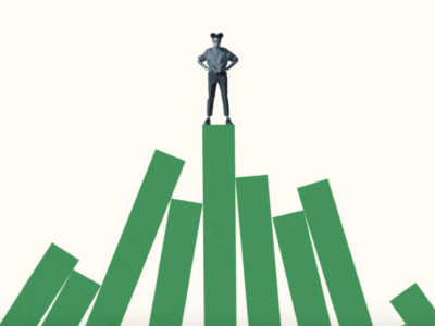 Getty Images: A girl stands atop a mountain of bar graphs.