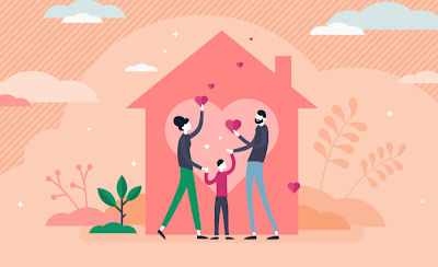 A family holds hearts up inside of a house. Credit: Charity Navigator