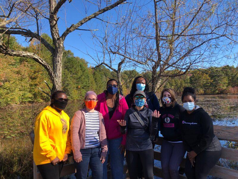 Team photo outside wearing masks